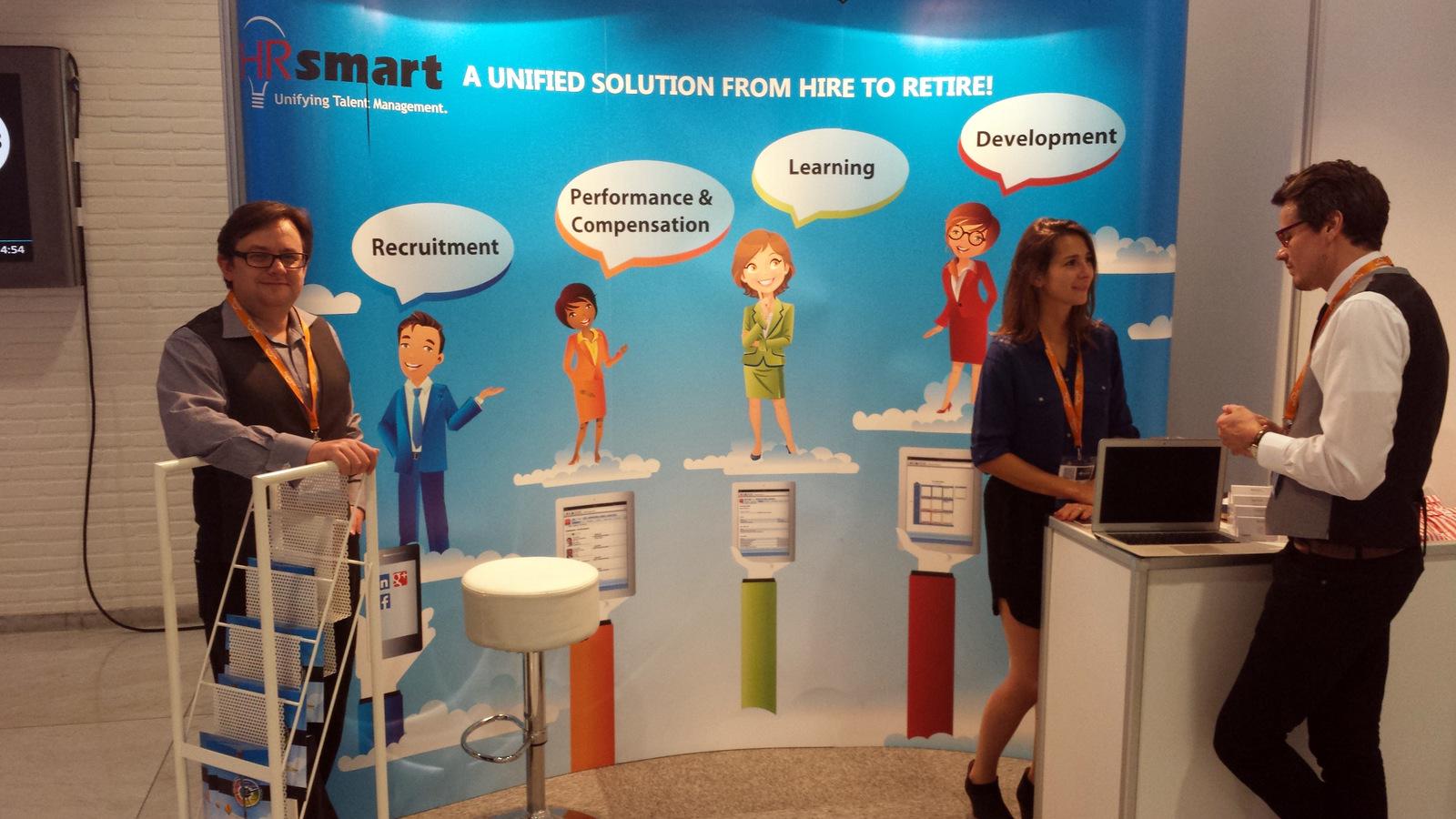 Nigel-Goodwin-&-Elise-Carbone-Demiraj-HRsmart-booth-@-HR-Tech-Europe-2014